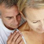Man comforting distressed wife — Stock Photo
