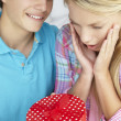 Stock Photo: Teenage boy giving gift to girl