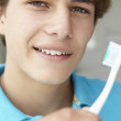 Stock Photo: Teenage boy with toothbrush