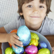 Foto Stock: Child with Easter eggs