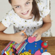 Young girl doing handicrafts — Stock Photo