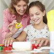Young girl baking with grandmother — Stock Photo #11883224