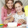 Young girl baking with grandmother — Stock Photo