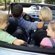 Family in sports car — Stock Photo