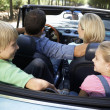 Family in sports car — Stock Photo #11883325