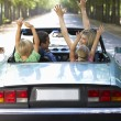 Family in sports car — Stock Photo #11883328