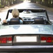 Woman in sports car — Stock Photo