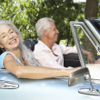 Senior couple in sports car — Stock Photo #11883345