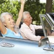 Senior couple in sports car — Stock Photo #11883347