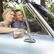 Couple in sports car — Stock Photo #11883350