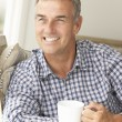 Mid age man at home — Stock Photo