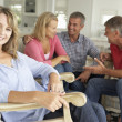 Mid age couples relaxing at home - Foto Stock