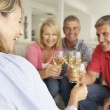 Stock Photo: Mid age couples drinking together at home