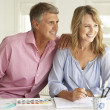Mid age couple painting with watercolors — Stock Photo