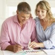 Mid age couple painting with watercolors — Stock Photo #11883416