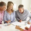 Mid age couples painting with watercolors — Stockfoto #11883418