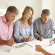 Mid age couples painting with watercolors — Stockfoto