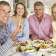 Mid age couples enjoying meal at home — Stock Photo #11883434