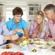Family enjoying meal at home - Foto Stock