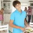 Teenagers reluctantly doing housework — Stock Photo