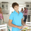 Teenagers not enjoying housework - 图库照片
