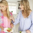 Mother and teenage daughter arguing about housework — Stock Photo