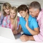 Family using laptop — Stock Photo #11883499
