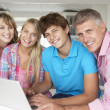Stock Photo: Family using laptop