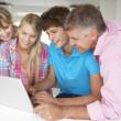 Family using laptop — Stock Photo #11883501