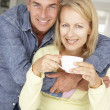 Stock Photo: Mid age couple with coffee at home