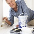 Senior man decorating house — Stock Photo #11883536