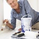 Senior man decorating house — Stock Photo