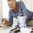 Senior man decorating house — Stock Photo