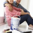 Senior couple decorating house — Stock Photo