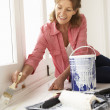 Senior woman decorating house — Stock Photo