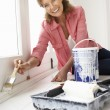 Senior woman decorating house — Stock Photo #11883547