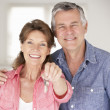 Senior couple moving into new home - Stock Photo