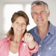 Senior couple moving into new home — Stock Photo #11883553