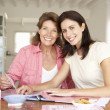 Stock Photo: adult mother and daughter scrapbooking