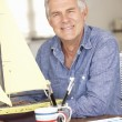 Senior man model making - Stock Photo