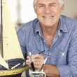 Senior man model making — Stock Photo