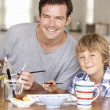 Father model making with son — Stock Photo #11883604