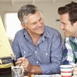 Stock Photo: Adult father and son model making