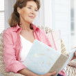 Senior woman with photo album — Stock Photo #11883628