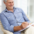 Senior man sketching — Stock Photo