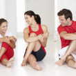 Mother,father and daughter doing yoga - Stock Photo