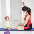 Mother and baby doing yoga — Stock Photo