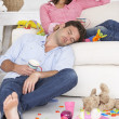 Foto Stock: Exhausted parents resting