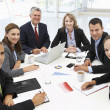 Mixed group in business meeting — Stockfoto