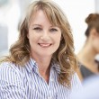 Mid age businesswoman in meeting — Stock Photo #11883740